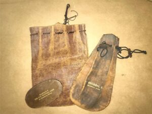 photo of 3 old leather coin purses