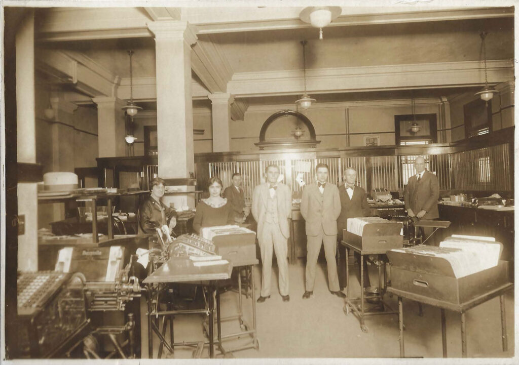 Interior of bank with personnel in 1928