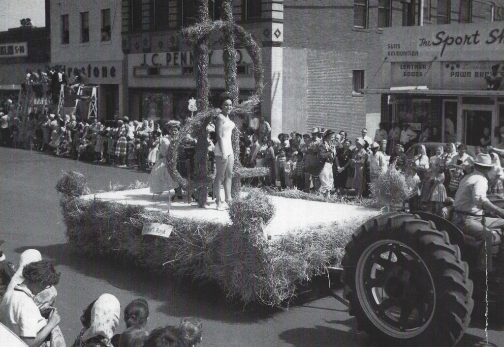 woman standing on parade float